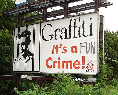 """Graffiti, It's a crime."" on a billboard. Edited to say ""Graffitti, it's a FUN crime!"""