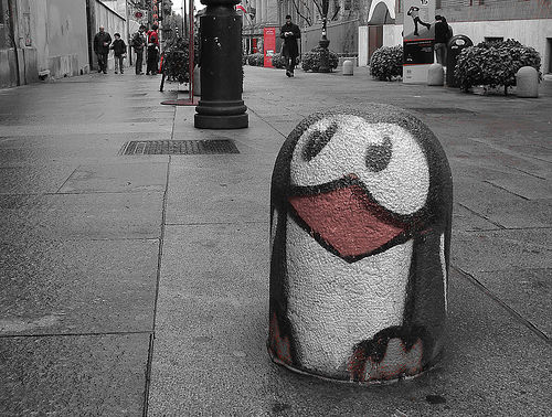 cement sidwalk ordiment sprayed to look like a penguin!