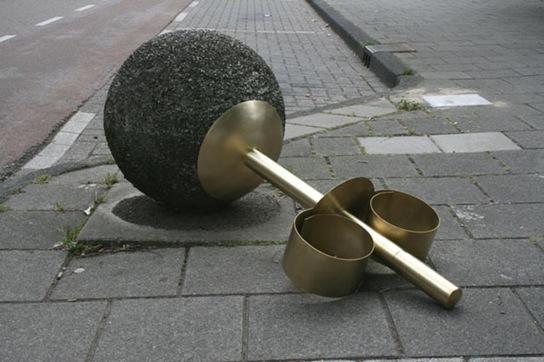Cement sphere sidewalk ornament turned giant earring.
