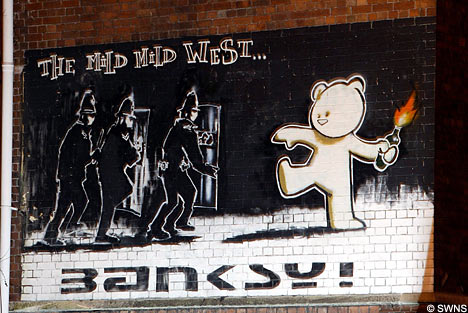 Banksy Bear tossing grenades at English cops