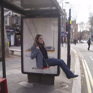 Swinging bus shelter
